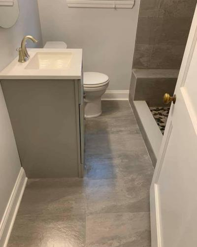 "alt=""New toilet and bathroom sink installation by South Jersey contractors"""