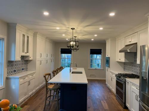 Knocked down kitchen and dining room wall to remodel kitchen and create open concept