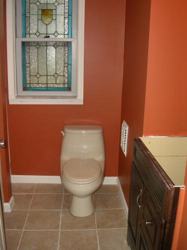"""alt=""""New toilet installed by Three Brothers Builders"""""""